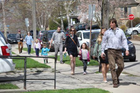 Families walking down sidewalk to Paris Presbyterian church